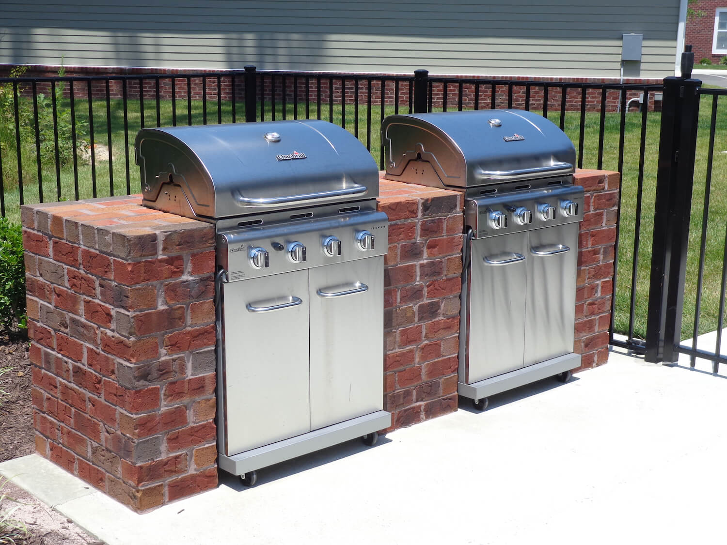Built-in stainless steel gas grills with four burners each.