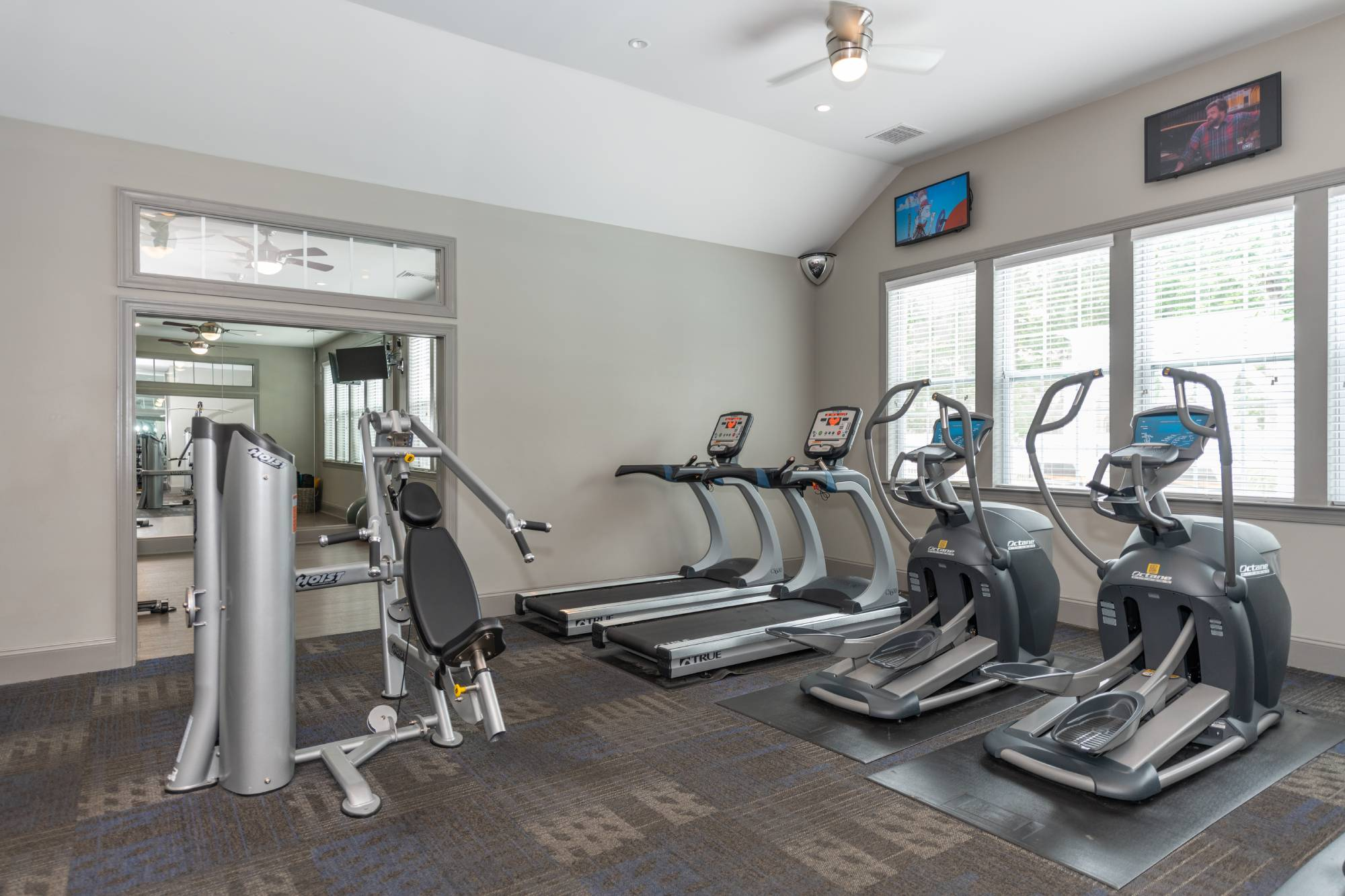 Commonwealth at York fitness center with elliptical machines.